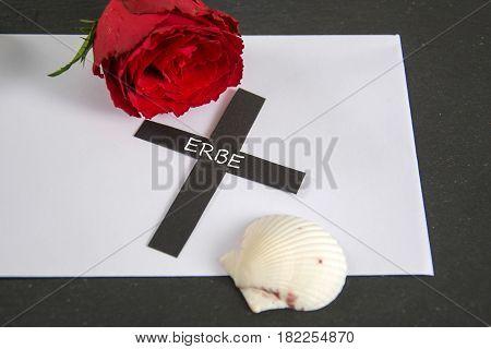 Erbe  - german for heritage - written on a black cross