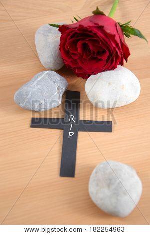 RIP - written on a black cross