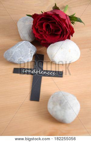 condlences - written on a black cross
