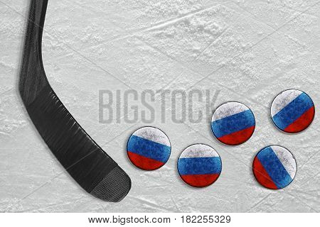 Stick and Russian washers on the ice of the hockey field. Concept background hockey