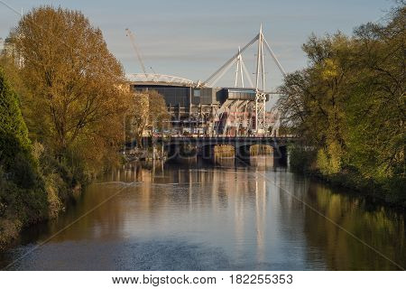 CARDIFF, UK -11 APRIL 2017 Millennium Stadium and River Taff from Bute Park. National stadium of Wales in evening light in Cardiff UK