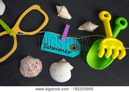 Sommer - german for summer -  written on paper tag