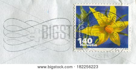 GOMEL, BELARUS, APRIL 17, 2017. Stamp printed in Switzerland shows image of  The Lycopersicon lycopersicum, circa 2012.