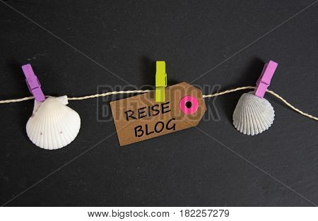 Reiseblog - german for travel blog - written on a paper tag