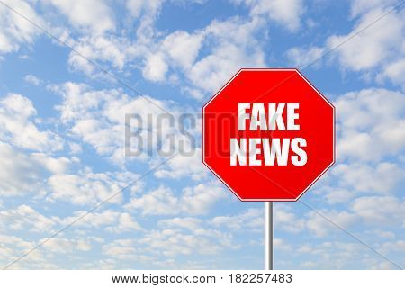 Stop fake news road sign against blue sky