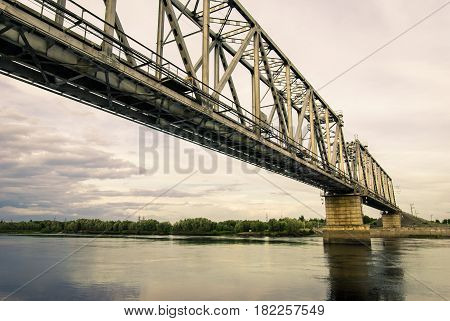 Railway bridge across the Agan river , the right tributary of the Ob river, in Western Siberia Khanty-Mansiysk Autonomous District.