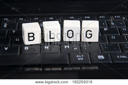 the word blog on a black  keyboard