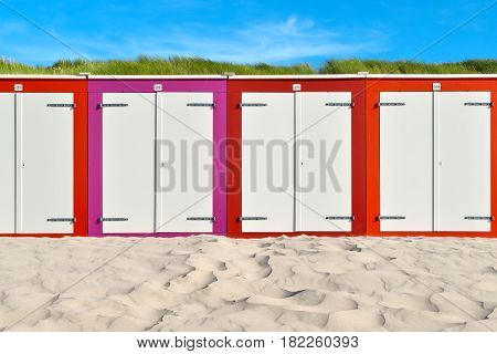 On the Beach by the Sea - beautiful colorful beach huts on a sandy beach on a sunny day