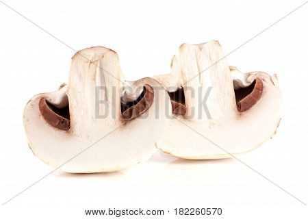 champignon mushrooms half isolated on white background.