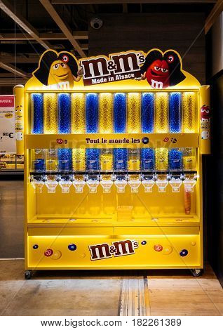 PARIS FRANCE - APR 10 2017: M&M's chocolate stande inside Ikea furniture store with the slogan Made in Alsace