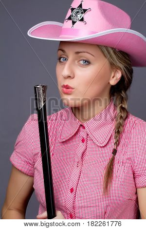 Attractive Cawbow Girl With Shot Gun Over Back