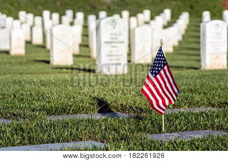 A flag on a grave at a southern California cemetery.
