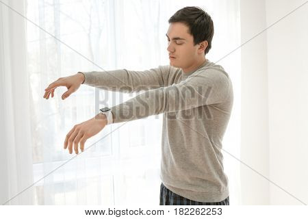 Young man suffering from sleepwalking at home