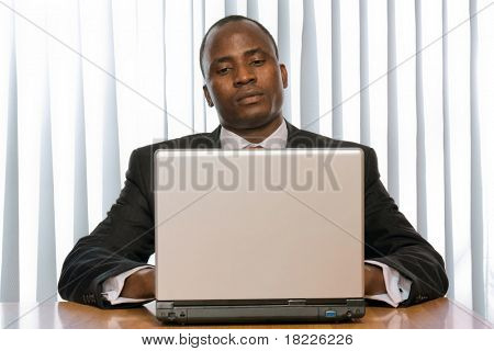 african amercian businees man working on his laptop