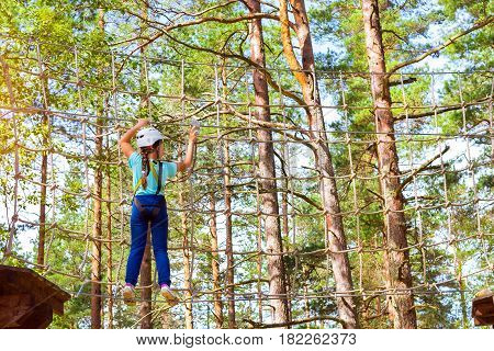 Girl On Hinged Trail In Extreme Rope Park