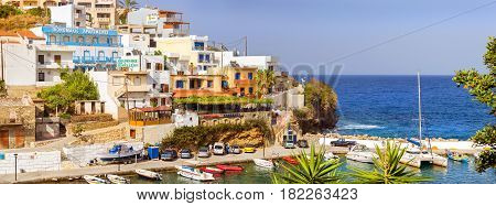 Bali Greece - April 30 2016: Harbour with marine vessels boats and lighthouse. Sea view at bay. Bali is vacation destination resort with secluded beaches. Rethymno Crete Greece