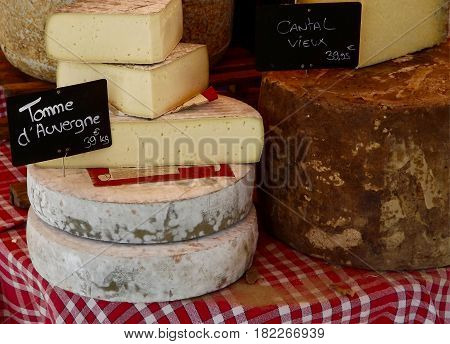Cheeses on a specialist market stall in rural France