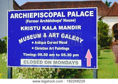 Goa, India - November 16, 2012: Tourist stone sign for tourists about Archbishop's Palace near SE Cathedral which houses the Museum and art gallery, Old Goa, India.
