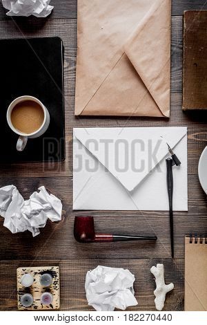 author office with coffee and envelope in professional writer concept on wooden work desk background top view