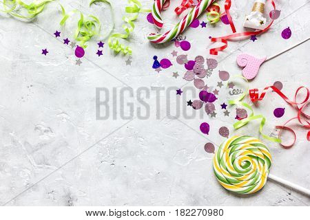birthday party design with colorful confetti on stone table background top view space for text
