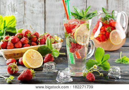 Fruit smoothie with strawberries and lemon on a wooden table