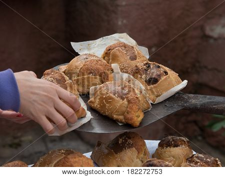 Traditional Cypriot easter pastries made with mixture of various cheese and halloumi called flaounes