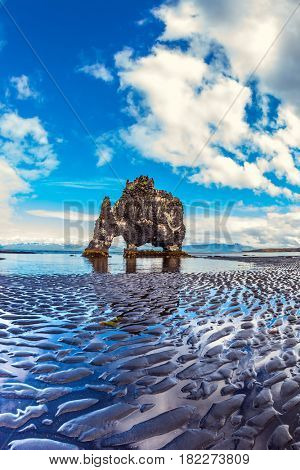 Concept of northern extreme tourism. Magic Rock Hvitsercur at sunset. Northern coast of Iceland