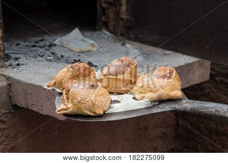 Traditional Cypriot easter pastries made with mixture of various cheese and halloumi and cooked on a clay oven called flaounes