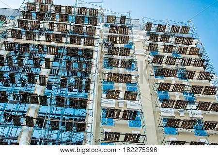 Scaffolding Near The Glass Facade Building Bright Sunny Day Blue Sky