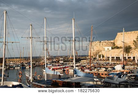 Kyrenia Cyprus - April 8. 2017: Harbour filled with yachts and boats at sunset at Kyrenia city harbor in Cyprus