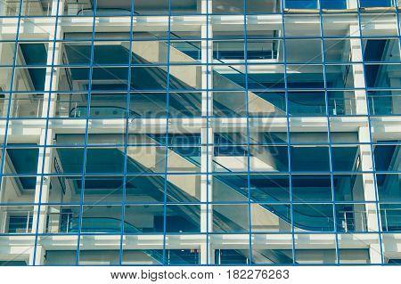 Glass Facade Of A Modern Building With Escalator.
