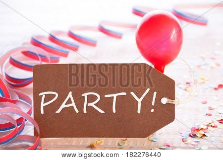 One Label With English Text Party. Party Decoration Like Streamer, Confetti And Balloon. Wooden Background With Vintage, Retro Or Rustic Syle