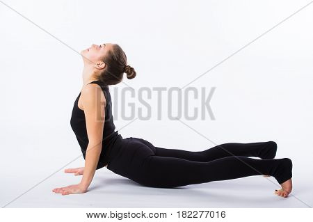 healthy yoga stretching woman does a downward facing dog. This is part of a series of various yoga poses by this model, isolated on white.