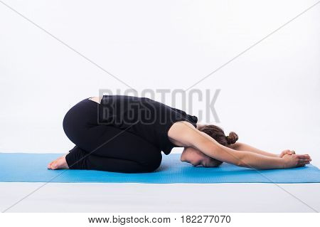 Beautiful sporty fit yogini woman practices yoga asana adhomukha svanasana - downward facing dog pose isolated on white.