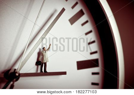 Miniature Waving businessman. Business concept. Macro photo