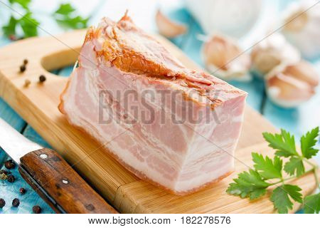 Smoked pork belly cured bacon on kitchen board