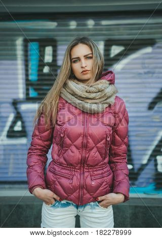 Woman on the street. Streetstyle look. Outumn or earlier spring in the city.
