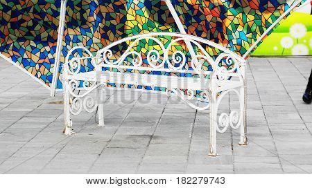 Bench under the umbrella. Street art object in the historic zone of Nalchik. Pedestrian street Kabardinskaya.