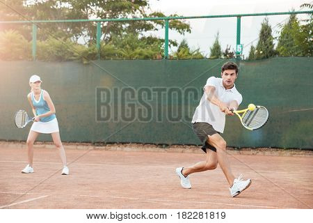 Couple playing in tennis on court