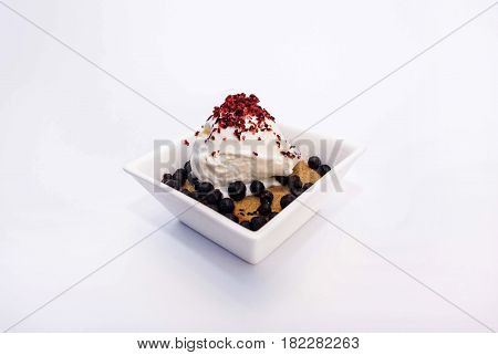 Ice cream with berry stuffing cream strawberries blueberries and cookies with chocolate