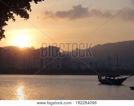 sun set at the beach, nightfall, sundown, eve, twilight, crepuscular light, sun fall poster