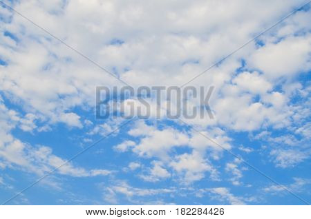 Blue sky with white and grey clouds.