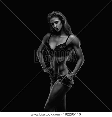 Fitness lady in studio on black background