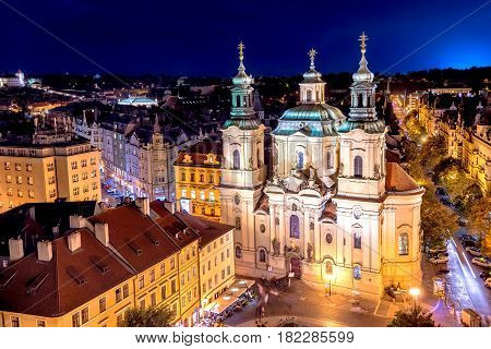 The Church of Saint Nicholas in the Old Town of Prague. View from Old Town Hall at night. Czech Republic.