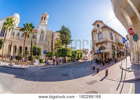 LIMASSOL CYPRUS - MARCH 18 2016: Tourists exploring the old town of Limassol. Cyprus.