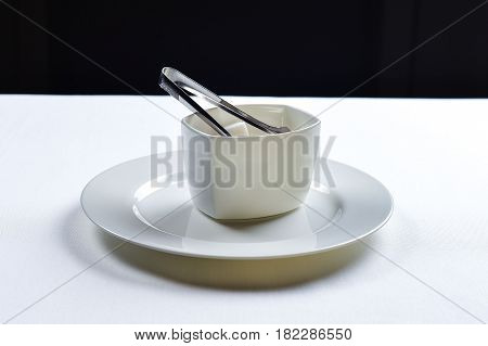 White refined sugar in a ceramic bowl on the table