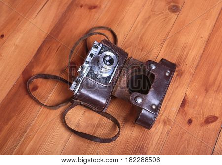 Vintage old film photo-camera in leather case.