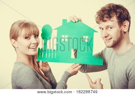 Young Couple With Ecological Green House.