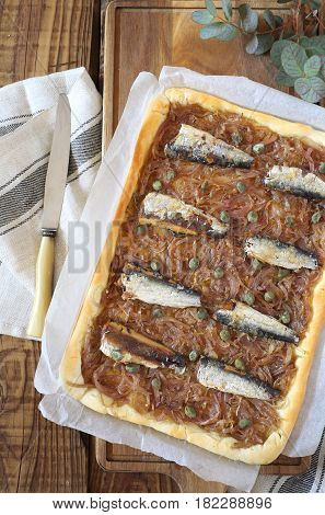French sardines onion pie with capers pissaladiere. Top view