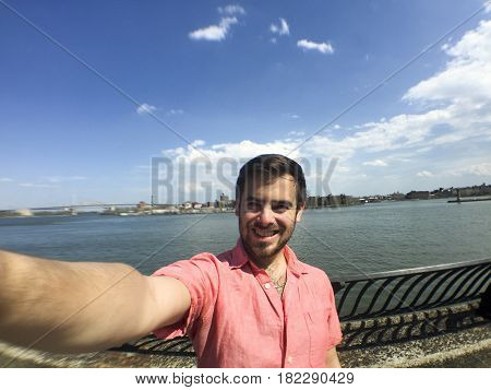 Handsome Man Takes Selfie On Sunny Day
